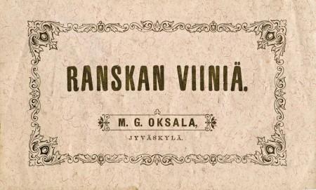 M.G. Oksalan kaupan viinietiketti.